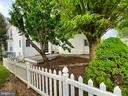 the backyard with a deck & mature trees . . - 134 BRADDOCK ST, CHARLES TOWN