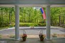Semicircle Driveway Overlooking Lush Front Grounds - 12970 WYCKLAND DR, CLIFTON