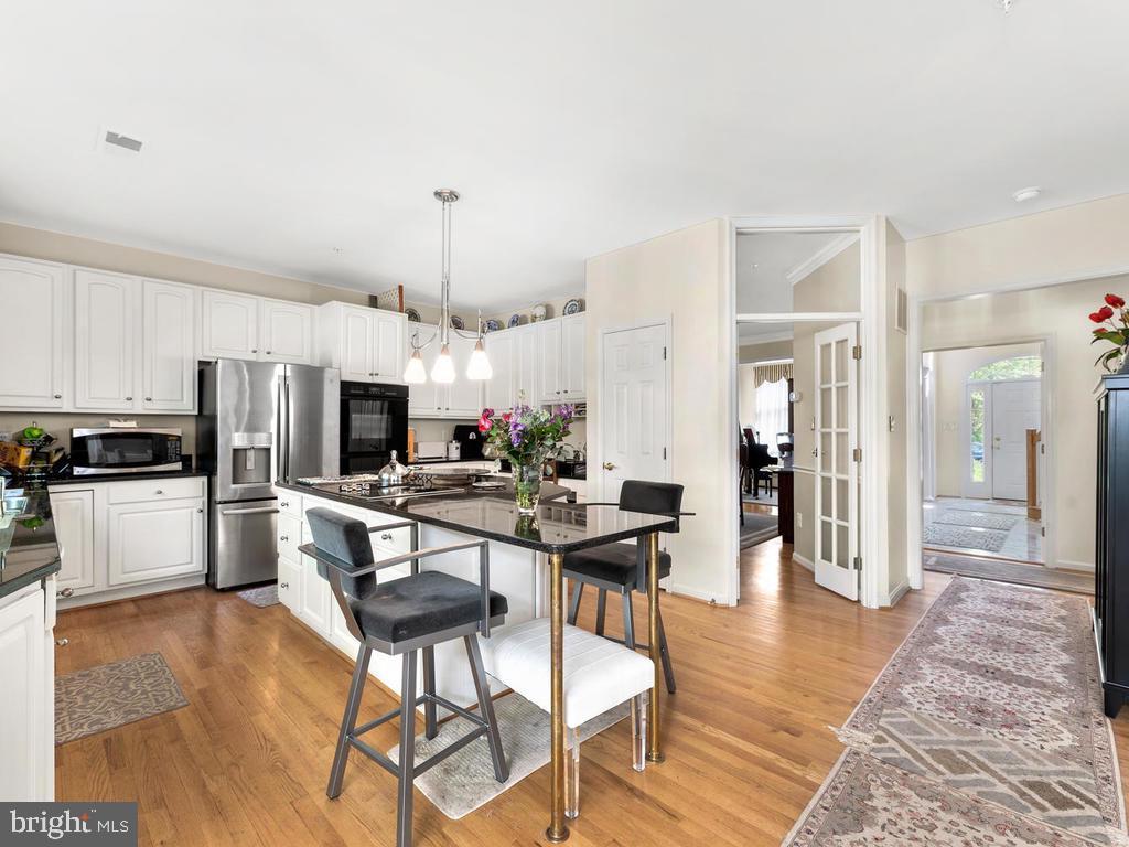 Kitchen #2 showing open floor plan - 4311 WOODBERRY ST, UNIVERSITY PARK