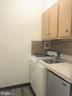 Kitchenette with new stove and flooring - 1021 ARLINGTON BLVD #337, ARLINGTON