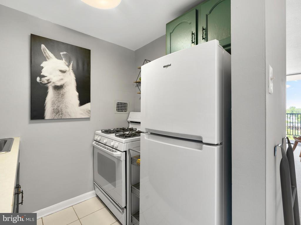Galley Kitchen with Gas Stove, New Refrigerator - 4 MONROE ST #711, ROCKVILLE