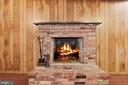 Recreation room fireplace with brick hearth - 7808 CHARLESTON DR, BETHESDA