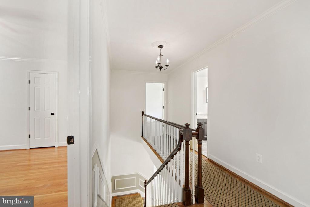 Upstairs hall with stylish carpet runner - 7808 CHARLESTON DR, BETHESDA