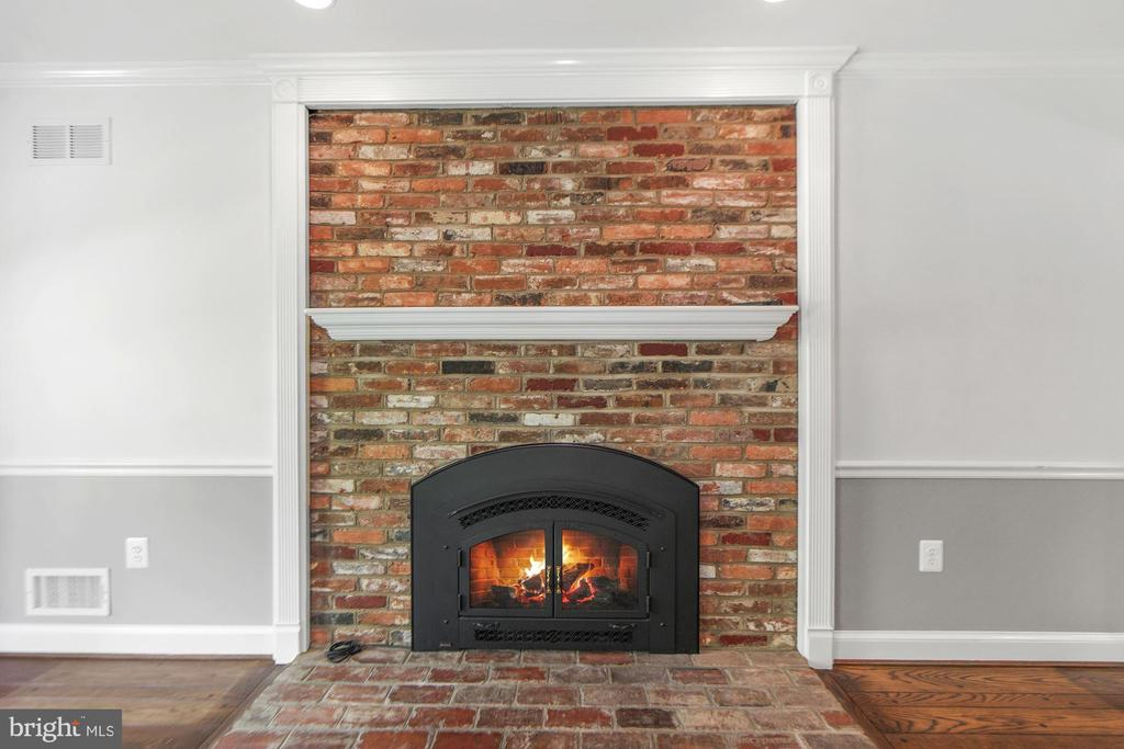 Wood burning fireplace with glass doors - 7808 CHARLESTON DR, BETHESDA