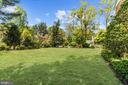Large yard will accommodate a swimming pool - 7808 CHARLESTON DR, BETHESDA