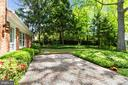 Mature shrubs and plants surround patio - 7808 CHARLESTON DR, BETHESDA