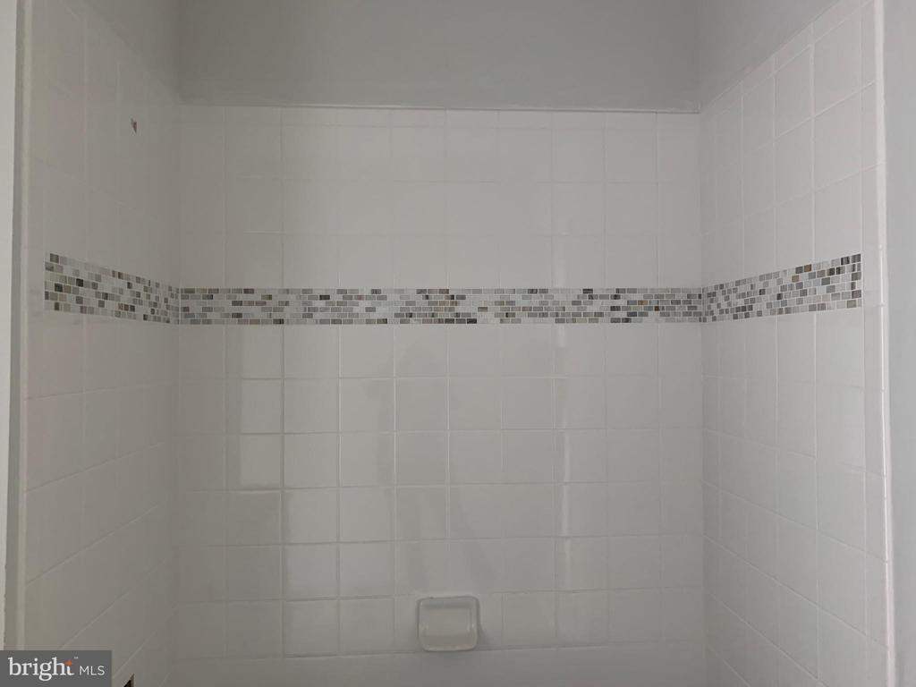 Accent tile in Buddy Bath - 7906 KENT RD, ALEXANDRIA