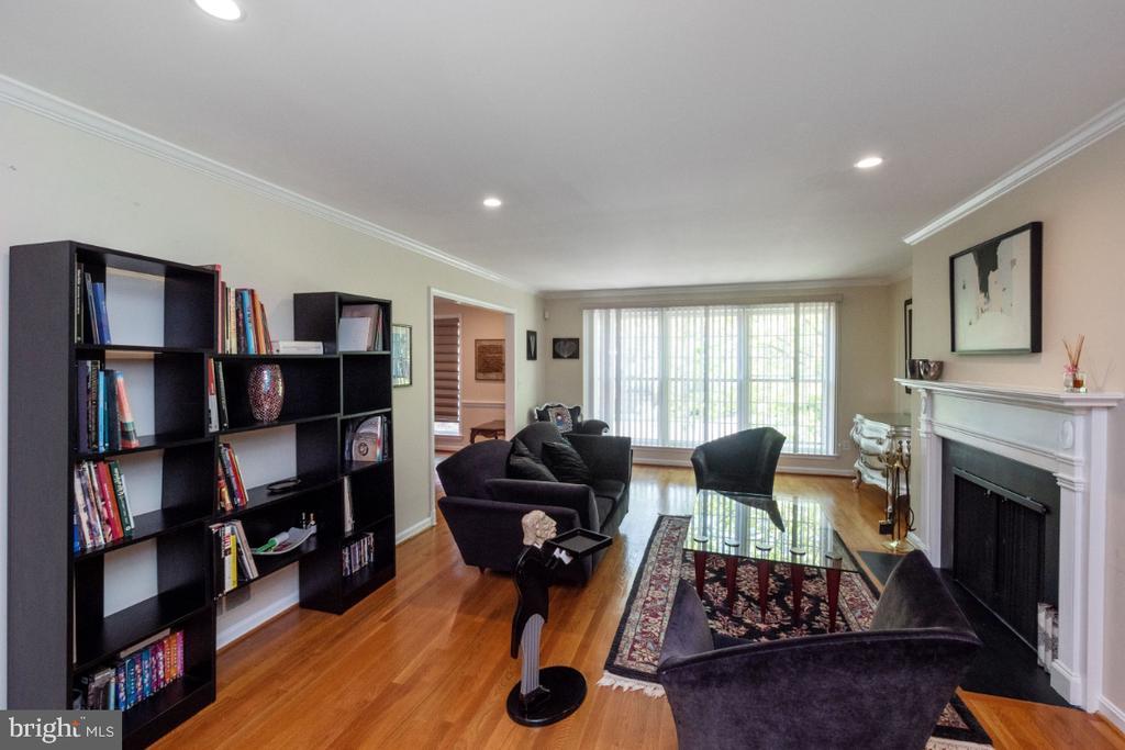 Living room with wood-burning fireplace - 4732 MASSACHUSETTS AVE NW, WASHINGTON