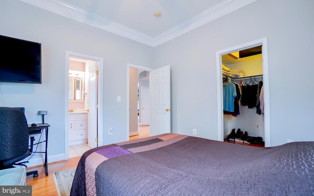 Walk-in closet. - 7709 WEBER ST, ANNANDALE