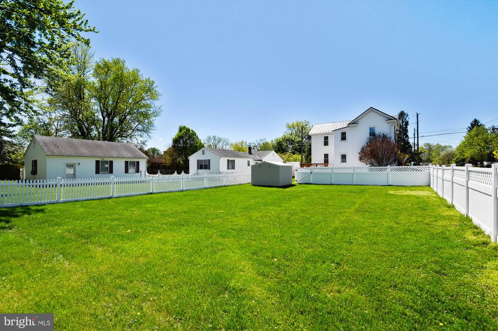 View of the house from the yard - 118 CATOCTIN CIR NE, LEESBURG