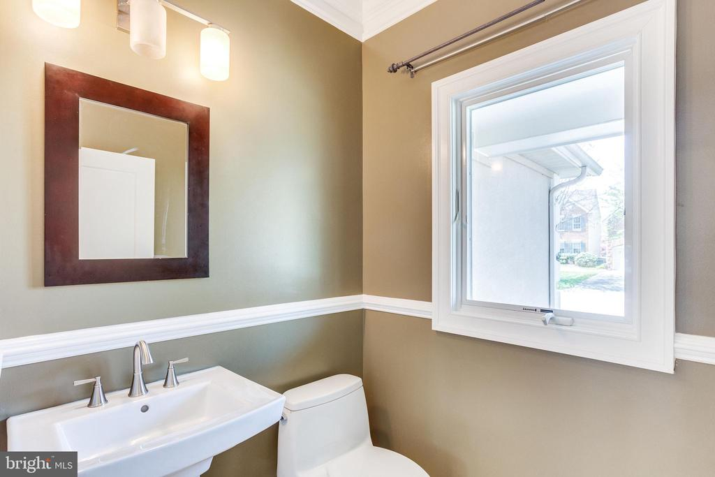 Powder Room with New Toilet, Sink & Hardware in Al - 10811 CRIPPEN VALE CT, RESTON