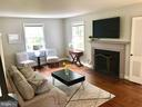 Living room with wood-burning fireplace - 7411 RIDGEWOOD AVE, CHEVY CHASE