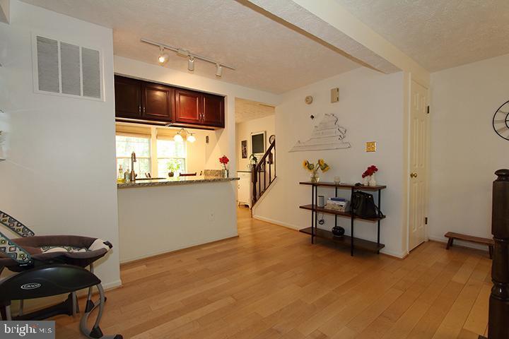 Family room  overlooking kitchen - 1594 WOODCREST DR, RESTON