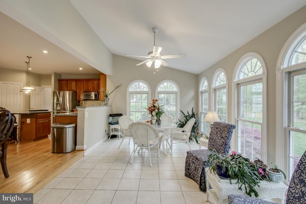 Sunroom with Palladian windows, tile flooring - 16917 OLD SAWMILL RD, WOODBINE