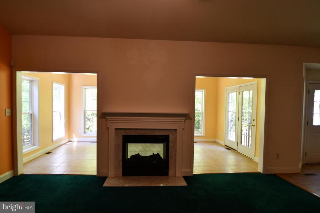 View of 2-side fireplace from family room - 79 MILLBROOK RD, STAFFORD