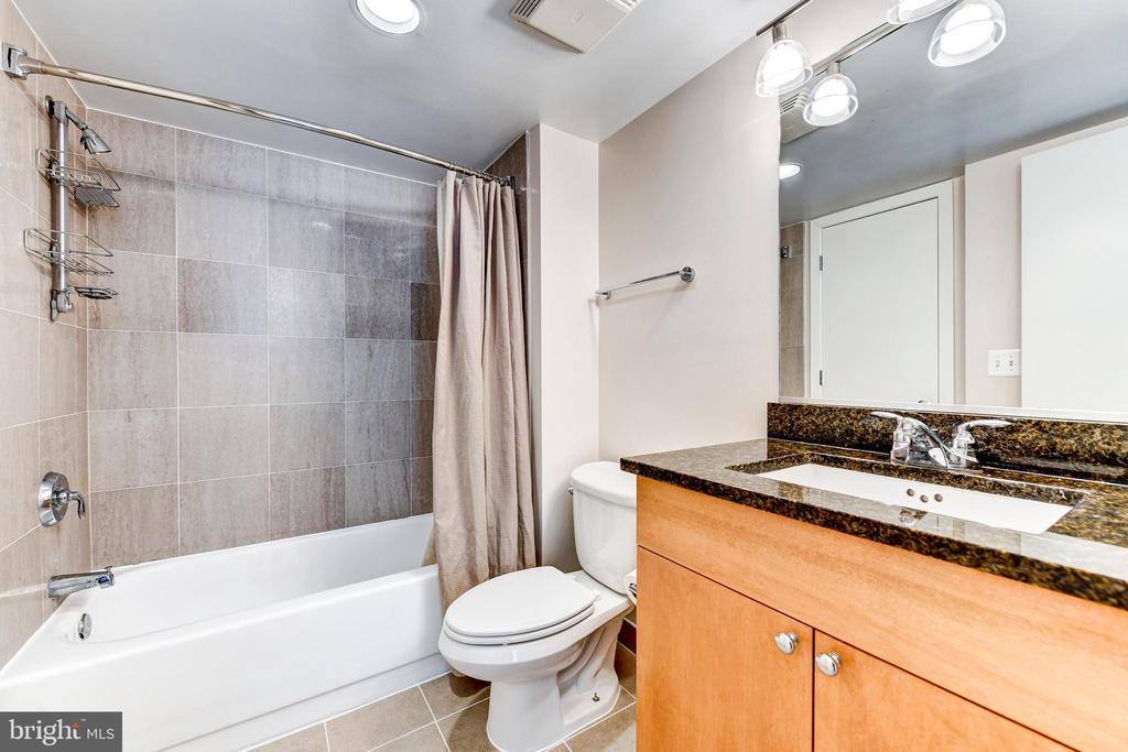 Full Bath with shower and tub. New tile flooring. - 7500 WOODMONT AVE #S902, BETHESDA
