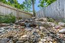 Love the backyard waterfall - 5900 RYLAND DR, BETHESDA