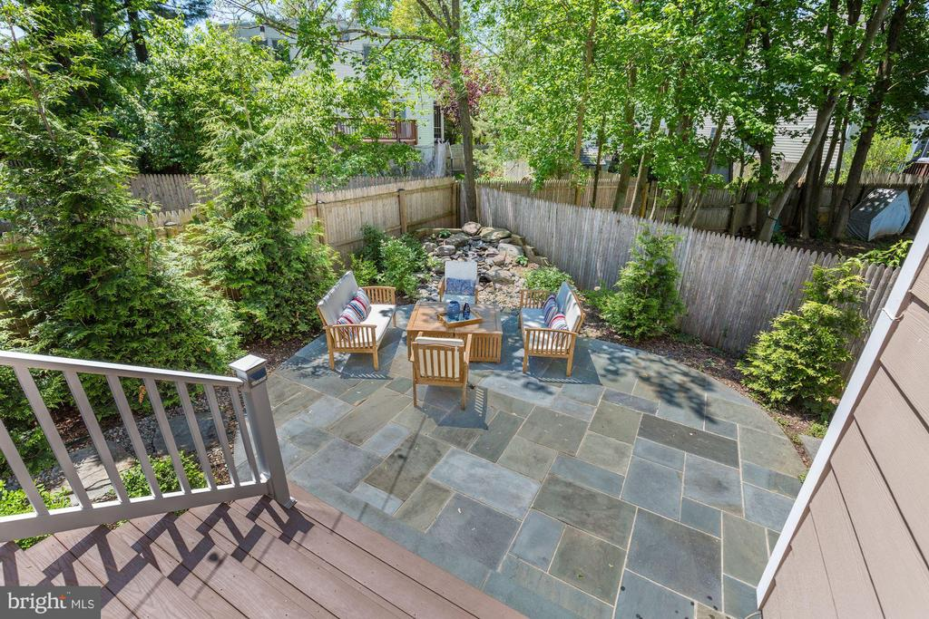 Flagstone patio with waterfall - 5900 RYLAND DR, BETHESDA