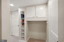 Built-in shelving and storage in lower level - 3030 N QUINCY ST, ARLINGTON