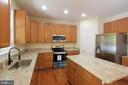 Kitchen - Large Island with Room for Stools - 612 LAKEVIEW PKWY, LOCUST GROVE