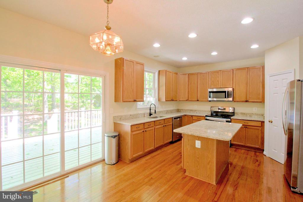 Kitchen - Note Sliding Doors open onto Deck - 612 LAKEVIEW PKWY, LOCUST GROVE