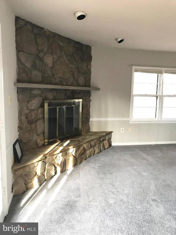 Stone fireplace in master suite - 6218 GLENVIEW CT, ALEXANDRIA