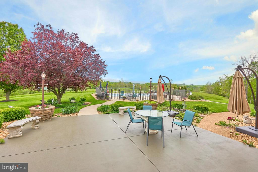 Patio overlooking pool yard and mountains - 345 GRIMSLEY RD, FLINT HILL