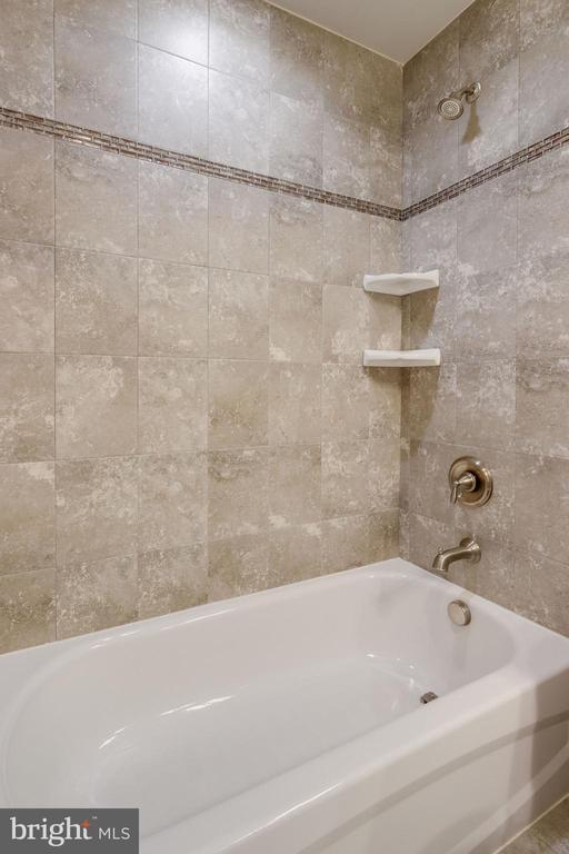 Tub/Shower Stone Tile finish - 2050 ARCH DR, FALLS CHURCH