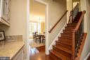 Oak staircase from kitchen - 42422 CHAMOIS CT, STERLING
