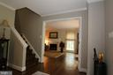 At front door, stairs up and looking to living rm - 10651 OAKTON RIDGE CT, OAKTON