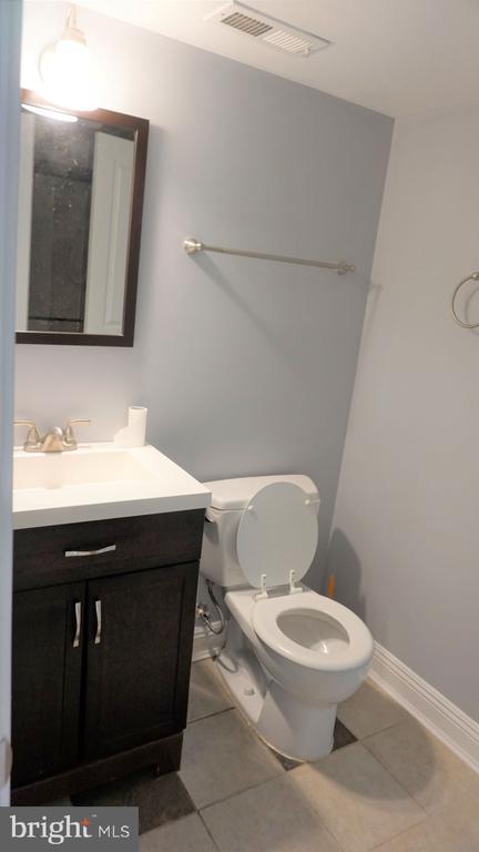 Basement Full Bath - Door Entr to Rm  & to Basemt - 7301 BRAD ST, FALLS CHURCH