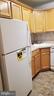Kitchen w/new refrigerator wood cabinets - 1615 Q ST NW #103, WASHINGTON
