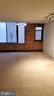 Living room windows w/ brick wall. - 1615 Q ST NW #103, WASHINGTON