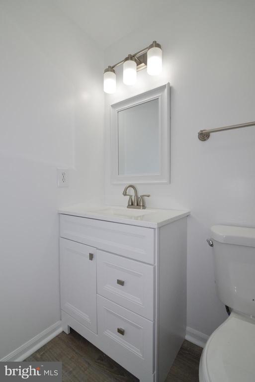 First floor 1/2 bath - 9306 KEVIN CT, MANASSAS PARK