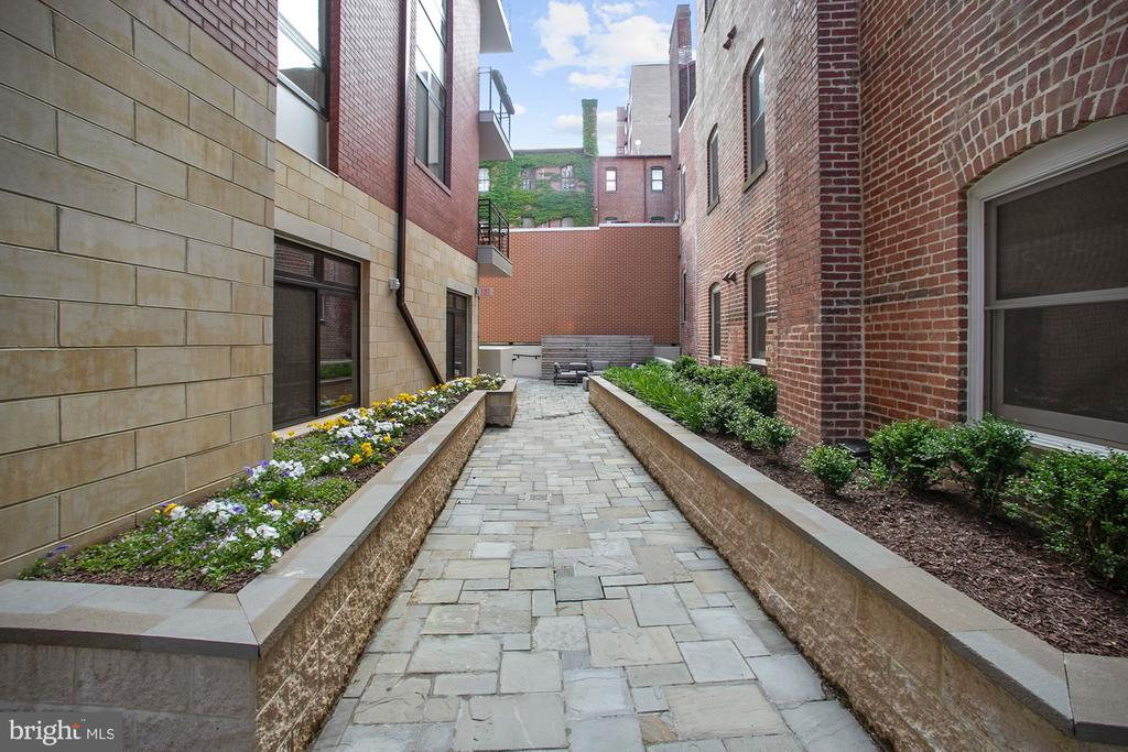 Right outside 103, the walkway to the courtyard - 1745 N ST NW #103, WASHINGTON