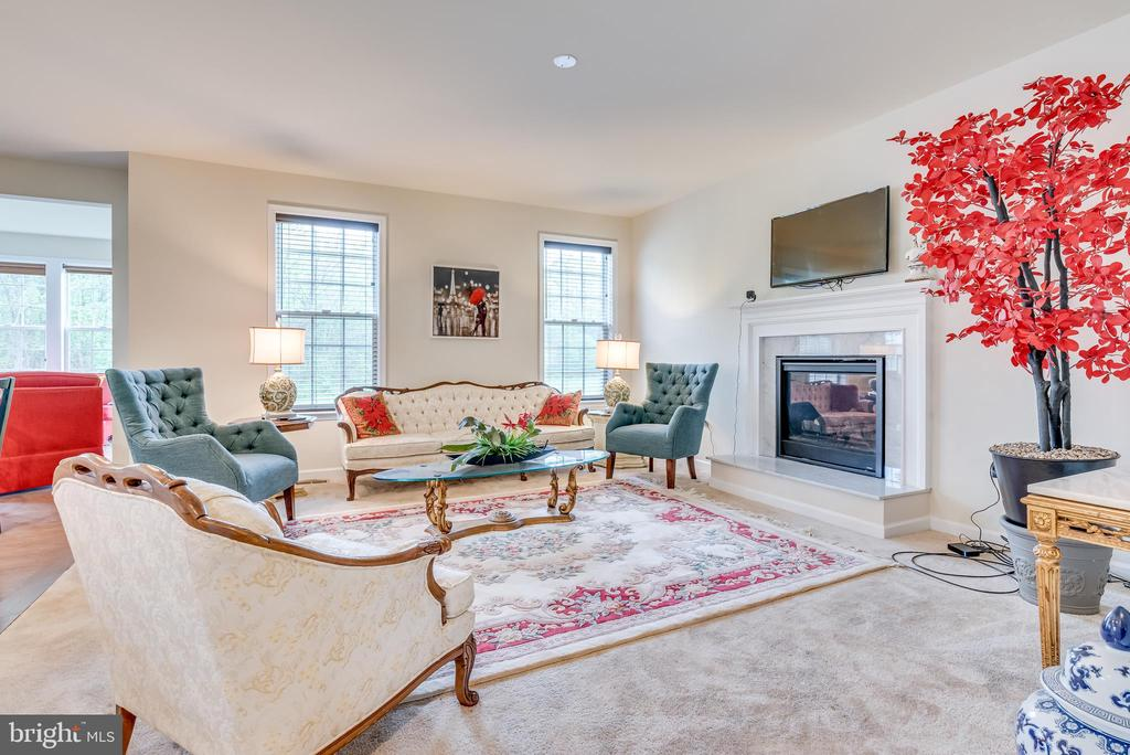 Spacious living room is comfortably carpeted - 440 FLIGHT O ARROWS WAY, MARTINSBURG