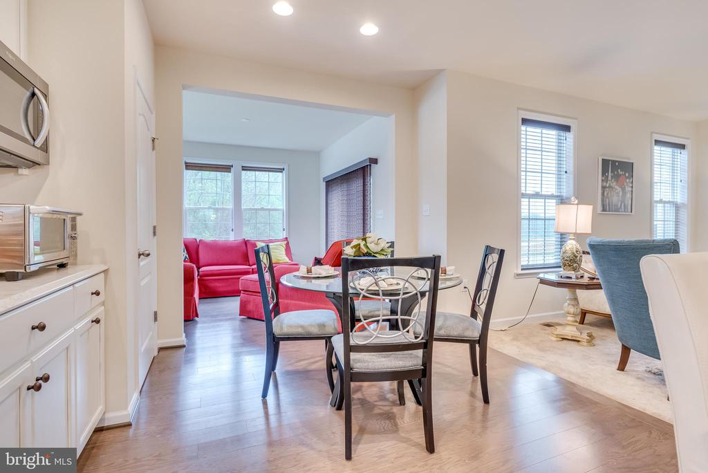 Breakfast nook features hardwood flooring - 440 FLIGHT O ARROWS WAY, MARTINSBURG