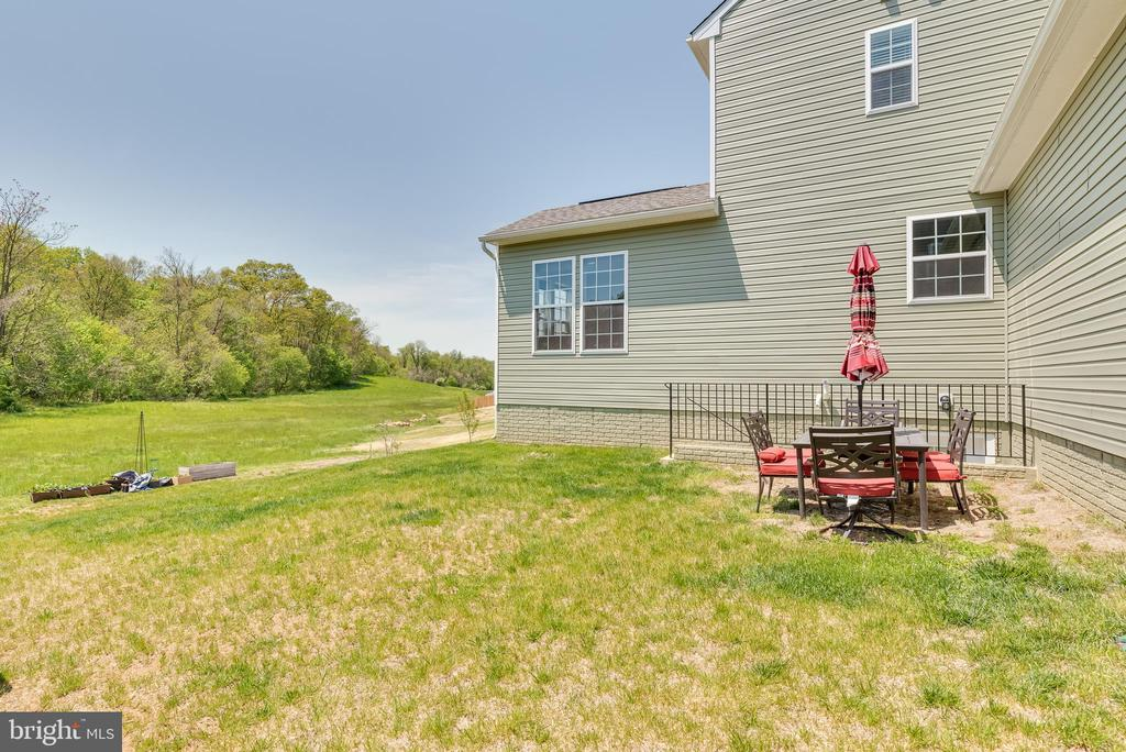 The rear of the home has space for patio furniture - 440 FLIGHT O ARROWS WAY, MARTINSBURG