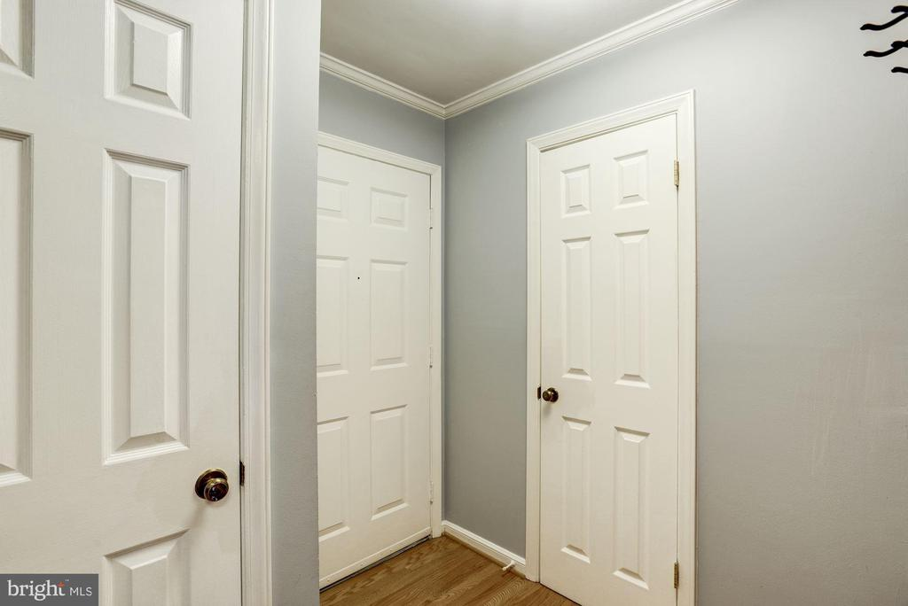 Entrance of home + Half Bathroom + Coat Closet - 1145 N UTAH ST #1145, ARLINGTON