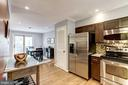 Kitchen Opens Beautifully to Dining Room - 1145 N UTAH ST #1145, ARLINGTON