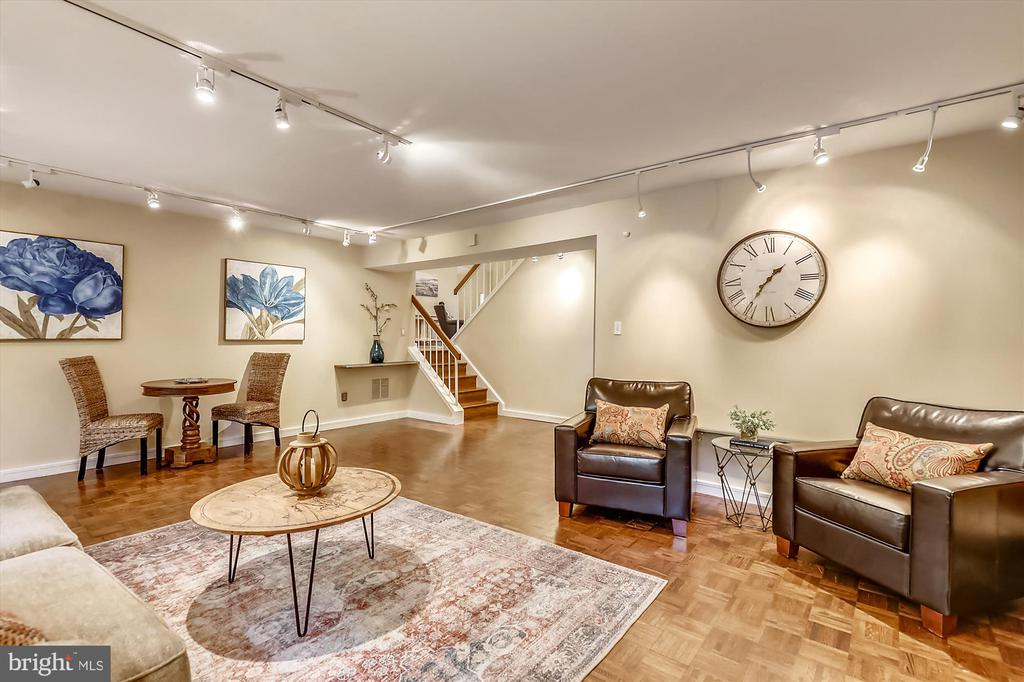 Lower Level Family Room - 6604 PERSIMMON TREE RD, BETHESDA