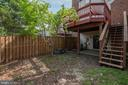 backyard with stairs to deck off kitchen - 14090 RED RIVER DR, CENTREVILLE