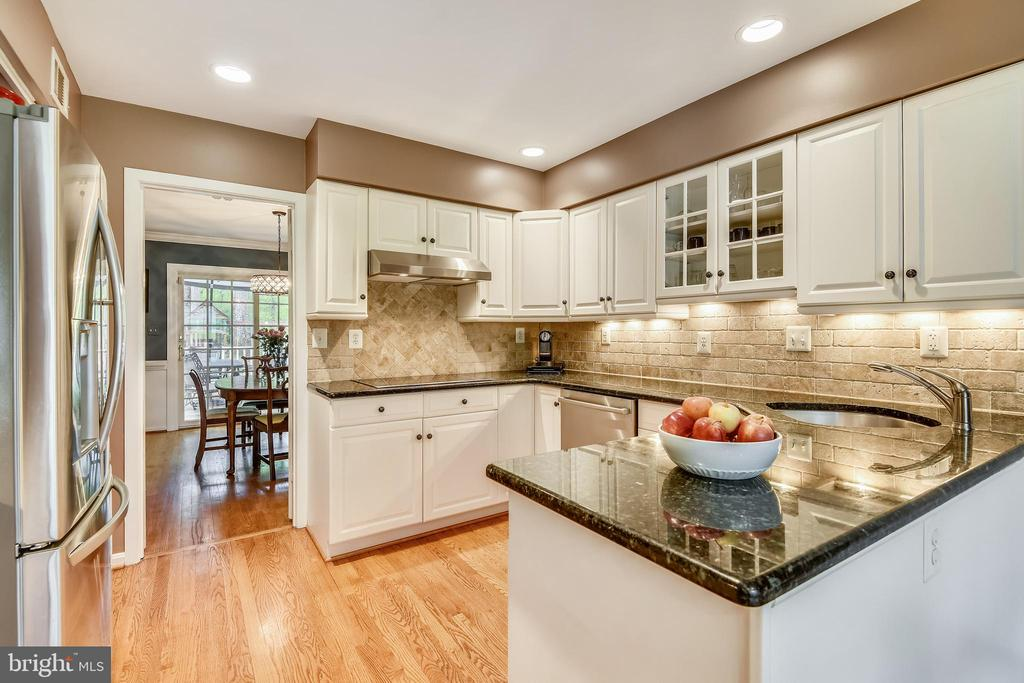 Granite counters.  Tile backsplash - 9706 FEROL DR, VIENNA