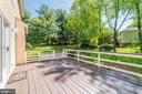 Elevated deck steps down to patio and grassy yard - 1331 STOKLEY WAY, VIENNA
