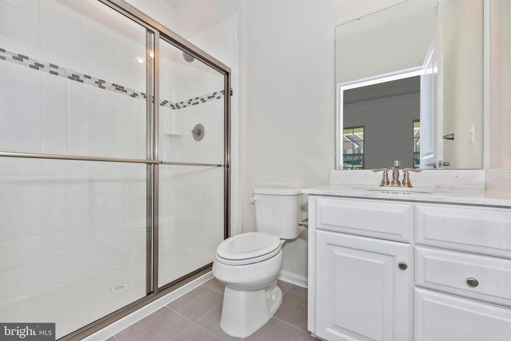 Full bath on the main level - 10058 HUTZELL ST, IJAMSVILLE