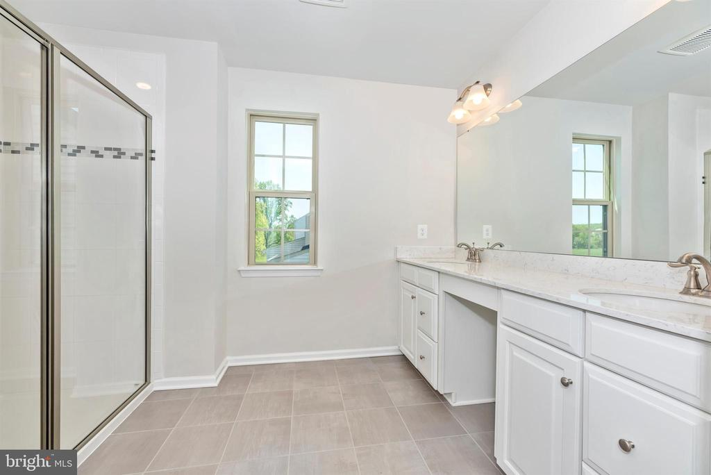 The master bath has comfort height counters - 10058 HUTZELL ST, IJAMSVILLE