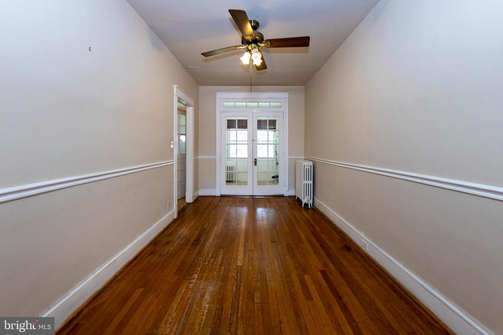 dining room with doors leading to bonus room - 2316 2ND ST NE, WASHINGTON