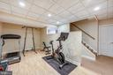 Full workout room in lower level - 3417 HIDDEN RIVER VIEW RD, ANNAPOLIS