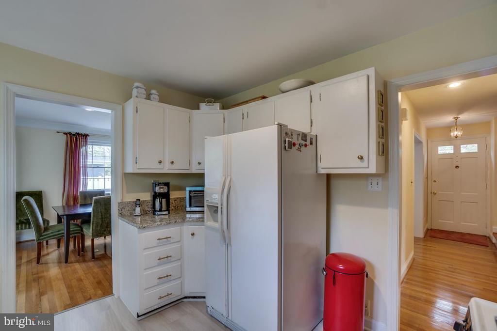 Kitchen: new flooring and cabinet hardware - 5824 BRADLEY BLVD, BETHESDA