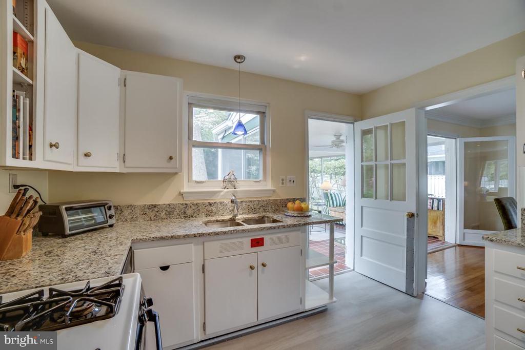 Kitchen: door out to sunroom; window to backyard - 5824 BRADLEY BLVD, BETHESDA